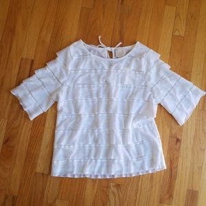 Anthropologie ruffled top.